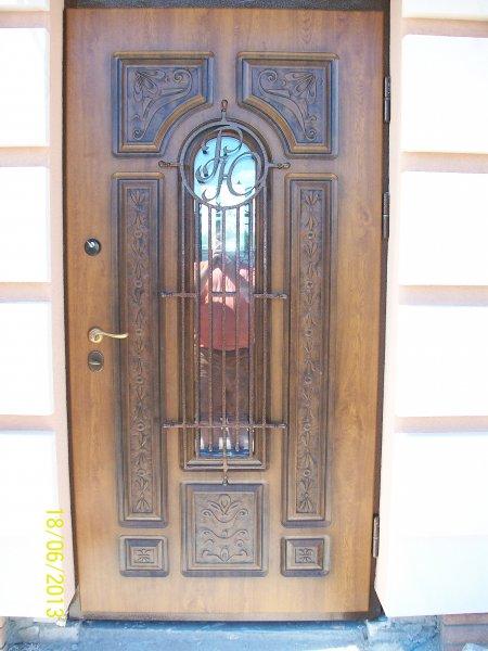 Фото  1 металлическая дверь с элементами ковки под стеклопакет. 1927229