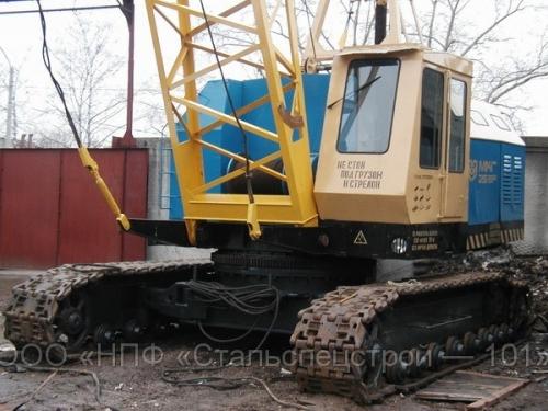 Аренда гусеничных кранов МКГ-25БР. Кран МКГ-25 самый распространенный строительный кран г/п 25 тонн