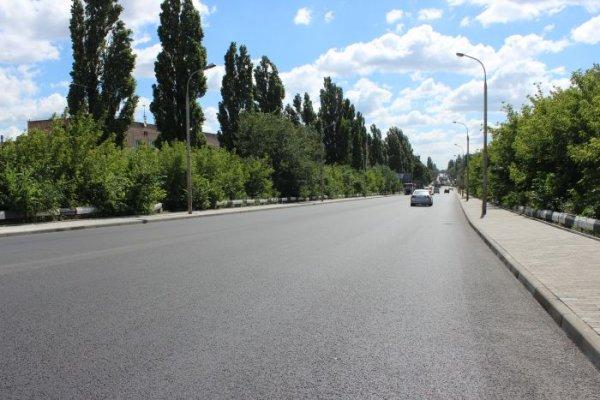 Фото  1 Влаштування асфальтного покриття 930278