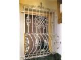 Решетки на окна из черного металла, с коваными элементами