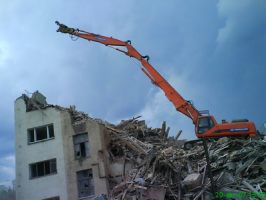 Демонтаж домов, несущих стен, железобетонных и металлических конструкций.