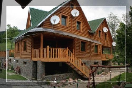 Дома деревянные из оцилиндрованного бревна из экологически чистого дерева Закарпатская смерека