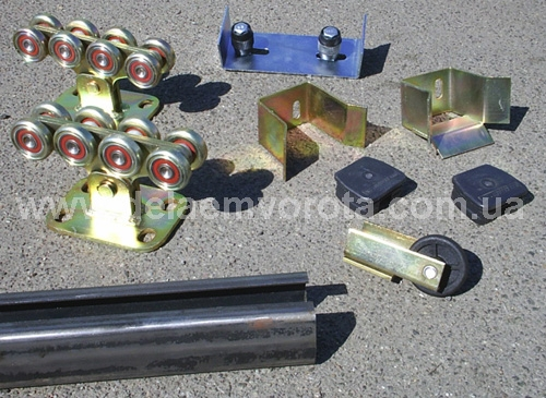 Комплект фурнитуры для откатных ворот до 400 кг, до 4 м. С металлическими роликами. (Украина).