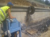 Резка настенной дисковой пилой конструкций из бетона, железобетона, кирпича. Вырезание проемов, каналов, штраб.