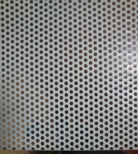 плиты потолочные для подвесного потолка из стали с покрытием полиэстер(Ral 9003белый с перфорированной поверхностью.
