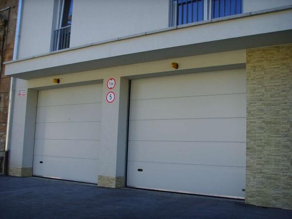 Секционные ворота Natura 3500х2000мм (h) Без узора. Цвет: белый Встроенная или боковая дверь: по заказу.