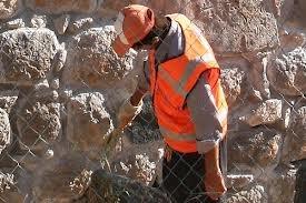 Штукатурка поверхностей известковым раствором улучшенная: по камню и бетону