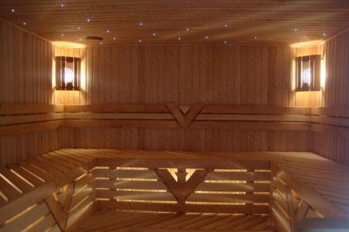 Строительство саун, бань в помещениях из ольхи и липы. Установка каменки дымохода.