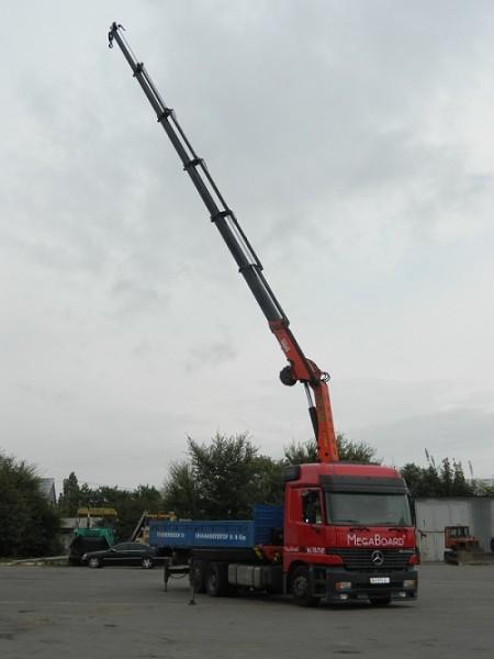 Услуги крана манипулятора в Одессе. Грузоподъемность крана 5 тонн, вылет стрелы 16 м.