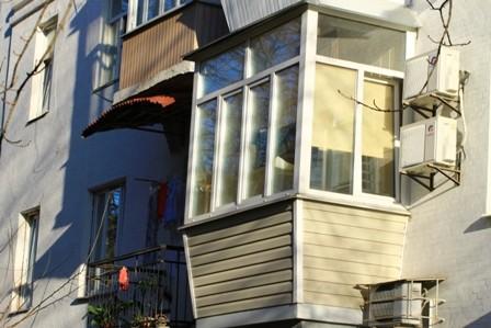 Внешняя обшивка балкона сайдингом